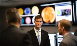 Retired Navy Rear Admiral and Deputy NOAA administrator Tim Gallaudet meets with scientists at