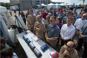 A crowd gathers to hear speeches and presentations during the Advanced Naval Technology Exercise