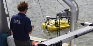 NOAA scientist operates an autonomous surface vehicle in the Port of Gulfport, Miss.