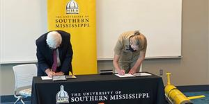 University of Southern Mississippi Vice President for Research Gordon Cannon, Ph.D, and Rear Adm.
